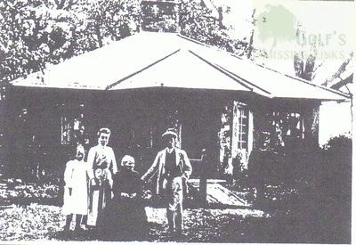 Barham Downs Golf Club. Mr Brown and his family outside the cottage.