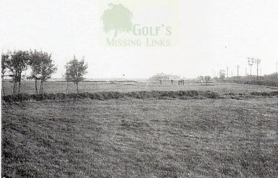 Chester Golf Club. Players on the sixteenth green.