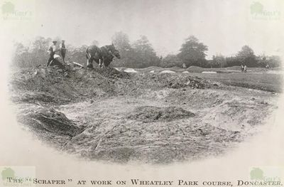 Wheatley Park Golf Club, Doncaster, Yorkshire. The scraper at work on the Wheatley Park golf course.